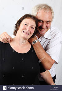 mature wife pic comp older mature married couple husband wife cuddling looking happy stock photo