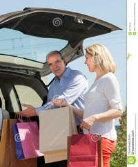 mature wife picture mature husband wife putting car shopping bags happy trunk stock photo