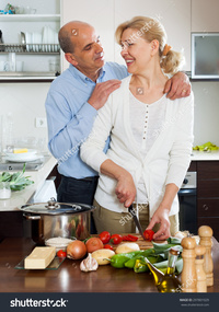 mature wife pix stock photo loving senior mature wife smiling preparing vegetables home kitchen pic