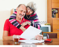 mature wife pix zooms cheeful mature man wife reading financial documents table aar stock photo write
