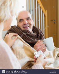 mature wife pix comp famrja attentive mature wife giving medicine sick husband home stock photo