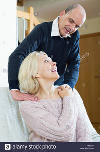 mature wife pix comp faf portrait senior smiling man giving tired mature wife back massage stock photo