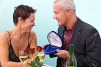 mature wife pix rtimages photo mature man giving his wife diamond necklace whilst sat table restaurant stock