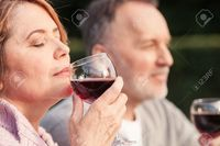 mature wife pix iakovenko cute mature husband wife are drinking wine joy they sitting grass smiling stock photo