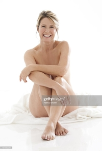 mature woman nude pics photos middle age woman sitting nude picture mature posing stock photo getty