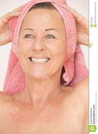 mature woman nudist joyful naked mature woman towel portrait attractive head happy relaxed friendly smiling isolated white royalty free stock