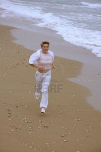 mature women photo pooh beautiful mature women running beach sea photo