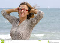 mature women pictures portrait mature woman stormy ocean weather stock photography
