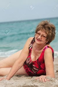 mature women pictures isame mature woman relaxing beach stock photo women older