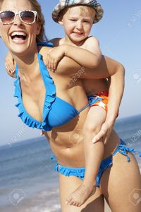 mom bikini pics stockbroker mother son running along beach stock photo bikini mom