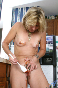 naked housewife pictures mature naked housewife wearing apron exposes tits sweet