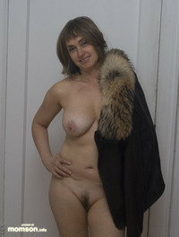 nude mom nude mother posing holding jacket
