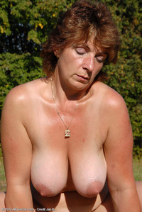 older milf photos milf porn all over busty mature pussy plugged outdoors