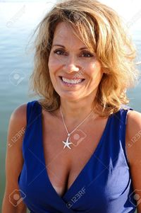 photo of mature women eyemark pretty woman wearing blue summer dress stock photo mature