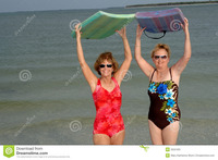 photo of mature women active mature women beach stock photos
