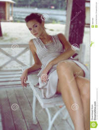 pics of sexy matures woman sitting gazebo wearing beige silk dress beautiful young sexy brown hair picked gentle natural makeup stock photo
