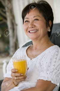 pictures of mature women moodboard woman drinking orange juice stock photo asian mature women