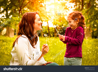 sexy mom having sex with daughter stock photo mother small daughter blowing dandelion lifestyle outdoors scene park pleasure search