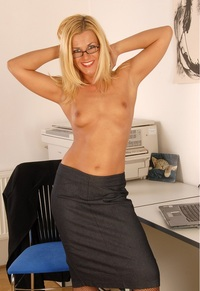 sexy pics milfs rate this sexy tanned blonde milf wearing glasses showing tits