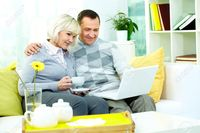 wife mature pic pressmaster portrait mature man his wife working laptop home stock photo