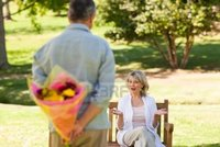 wife mature pic mature man offering flowers his wife photo