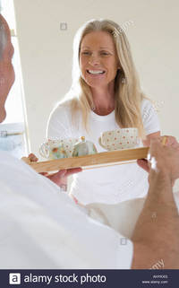 wife pics mature comp ahykxg mature man bringing wife breakfast bed carrying tray woman smiling stock photo