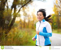 asian mature active woman running jogging middle aged asian mature female jogger outdoor living healthy lifestyle beautiful royalty free stock photos autumn city