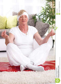 beautiful mature beautiful mature woman yoga lotus pose smiling senior exercise home royalty free stock photography