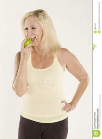 beautiful mature beautiful mature woman eating fresh green apple royalty free stock photo