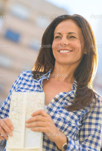 beautiful mature depositphotos happy mature woman holding map stock photo