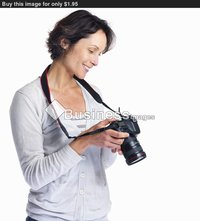 beautiful mature beautiful mature woman holding camera isolated white background buy stock photo female photographer checking here digital slr came