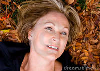 beautiful mature happy beautiful mature woman fall leaves stock photography
