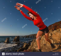 big mature comp bycych fit mature woman exercises outdoors along sur coastline pacific stock photo