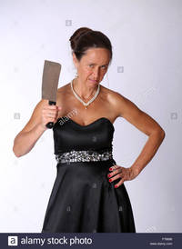 big mature comp mad mature woman knife meat cleaver stock photo