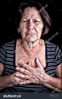 black mature stock photo mature woman suffering from chest pain depression black background pic