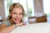 blond mature goodluz beautiful blond mature woman relaxing sofa photo