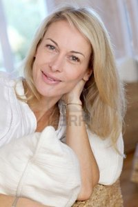 blond mature goodluz portrait blond mature woman relaxing sofa photo