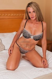 blonde mature disorderly beautiful mature blonde bed brown lingerie photo