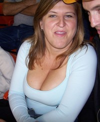 boobs mature mature woman shows off cleavage huge boobs low cut