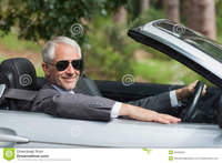 classy mature smiling mature businessman driving classy cabriolet sunny day royalty free stock photography