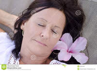 facial mature portrait beautiful mature woman sleeping smiling happy relaxed facial expression closed eyes flower hair