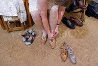 france mature preview mature woman trying pair shoes shoe shop paris france