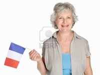france mature logos portrait happy mature woman holding flag france against white photo