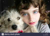 hairy bbw mature comp dog puppy girl hug portrait closeup blue eyes white hairy little stock photo