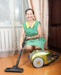 lady mature housework vacuum cleaner mature woman home photo