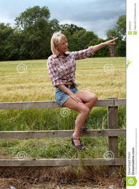 lady mature mature lady sitting fence pointing left royalty free stock photography