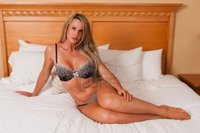 lingerie mature disorderly beautiful mature blonde bed brown lingerie photo