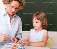 mature teacher depositphotos little girl working under supervision mature teacher stock photo