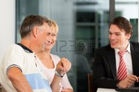 mature and young kzenon mature couple young financial consultant they are planning their retirement photo