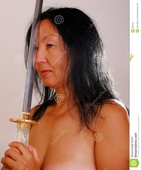 mature asia nude asian woman sword stock photography